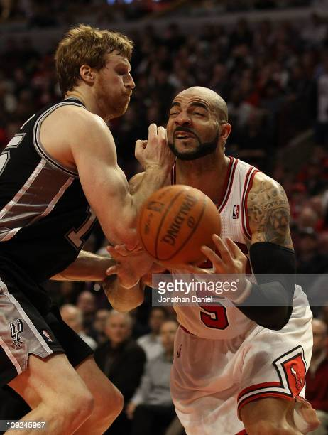 Carlos Boozer of the Chicago Bulls is hit in the face by Matt Bonner of the San Antonio Spurs at the United Center on February 17 2011 in Chicago...