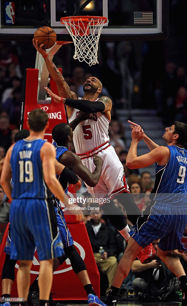 Carlos Boozer #5 of the Chicago Bulls puts up a shot against the Orlando Magic at the United Center on April 5, 2013 in Chicago, Illinois.