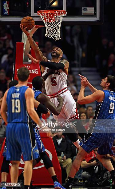 Carlos Boozer of the Chicago Bulls puts up a shot against the Orlando Magic at the United Center on April 5 2013 in Chicago Illinois NOTE TO USER...