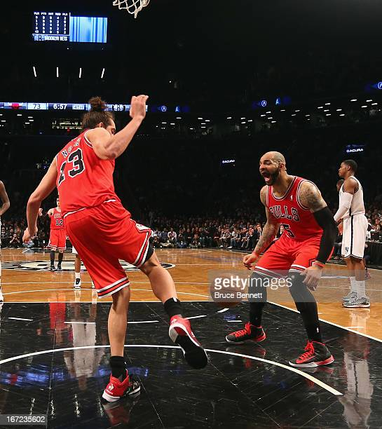 Carlos Boozer of the Chicago Bulls reacts after a slam dunk by Joakim Noah against the Brooklyn Nets during the second half of Game Two of the...