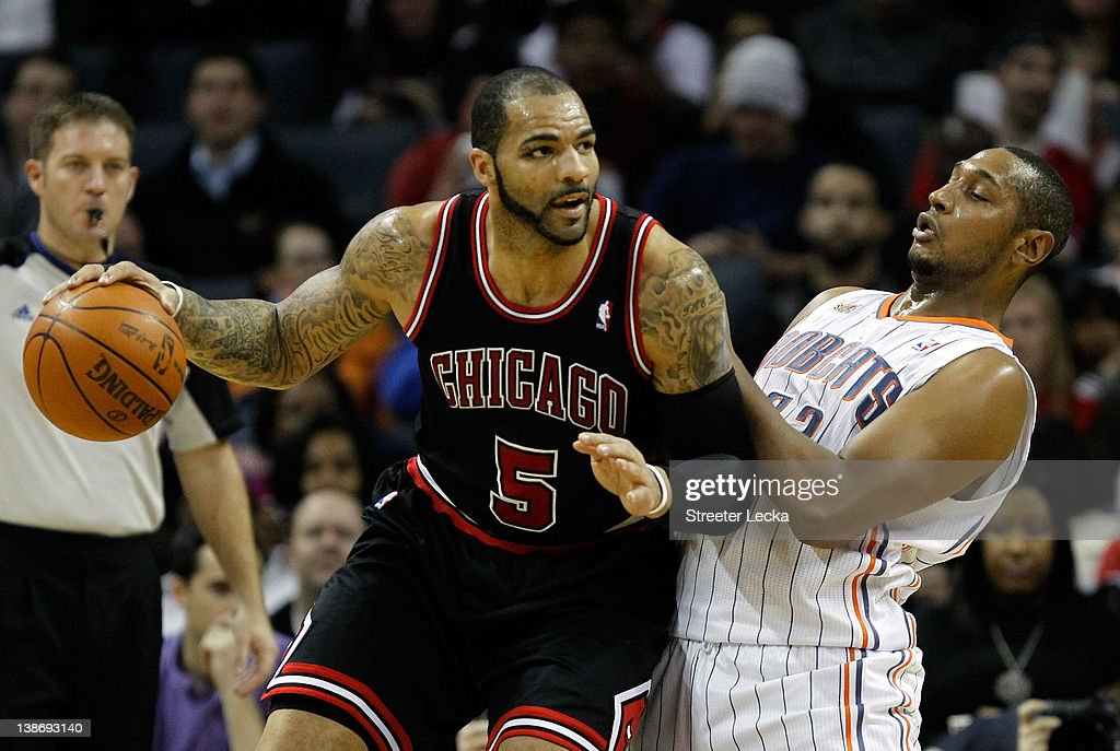 Carlos Boozer #5 of the Chicago Bulls runs into Boris Diaw #32 of the Charlotte Bobcats during their game at Time Warner Cable Arena on February 10, 2012 in Charlotte, North Carolina.