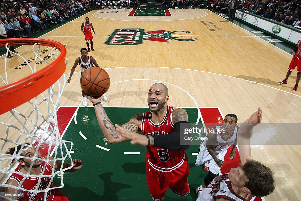 Carlos Boozer #5 of the Chicago Bulls shoots against Mike Dunleavy #17 of the Milwaukee Bucks during the NBA game on November 24, 2012 at the BMO Harris Bradley Center in Milwaukee, Wisconsin.