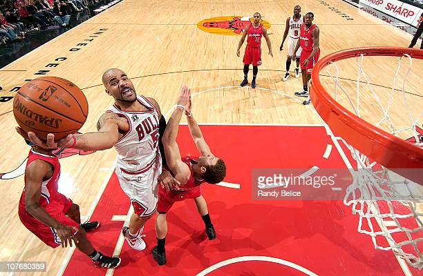 Carlos Boozer of the Chicago Bulls takes the ball up to the hoop over Blake Griffin of the Los Angeles Clippers during the NBA game on December 18...