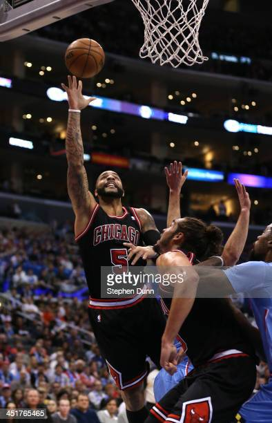 Carlos Boozer of the Chicago Bullsshoots against the Los Angeles Clippers at Staples Center on November 24 2013 in Los Angeles California NOTE TO...