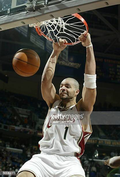 Carlos Boozer of the Cleveland Cavaliers dunks against the New Orleans Hornets on February 23 2004 at Gund Arena in Cleveland Ohio NOTE TO USER User...