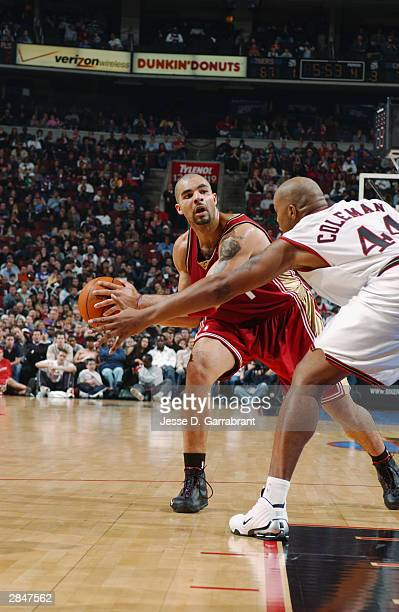 Carlos Boozer of the Cleveland Cavaliers looks to pass the ball against Derrick Coleman of the Philadelphia 76ers during the game at the Wachovia...