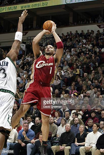 Carlos Boozer of the Cleveland Cavaliers puts the jump shot up over Oliver Miller of the Minnesota Timberwolves on February 6 2004 at the Target...