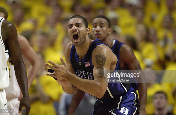 Carlos Boozer of the Duke Blue Devils celebrates during the ACC/Big Ten Challenge against the Iowa Hawkeyes at United Center in Chicago Illinois on...