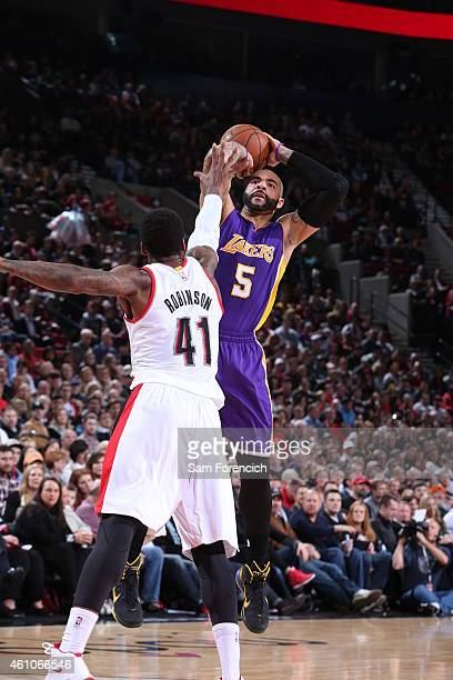Carlos Boozer of the Los Angeles Lakers shoots against Thomas Robinson of the Portland Trail Blazers on January 5 2015 at the Moda Center in Portland...