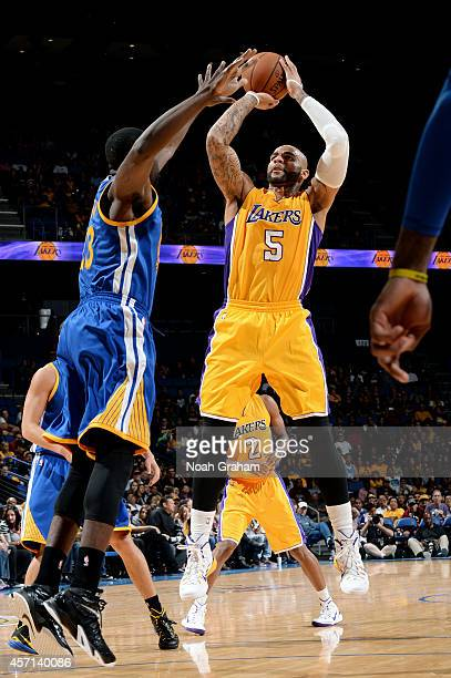 Carlos Boozer of the Los Angeles Lakers shoots the jumper during the game against the Golden State Warriors on October 12 2014 at Citizens Business...