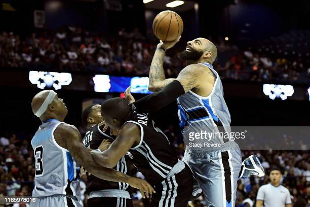 Carlos Boozer of the Power attempts a shot over Frank Robinson of the Enemies in the first half during week seven of the BIG3 three on three...