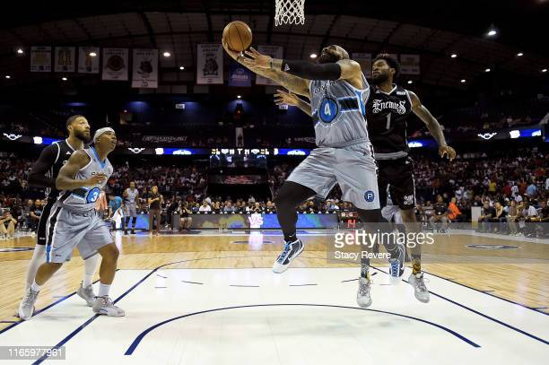 Carlos Boozer of the Power attempts a shot while being guarded by Perry Jones III of the Enemies in the second half during week seven of the BIG3...