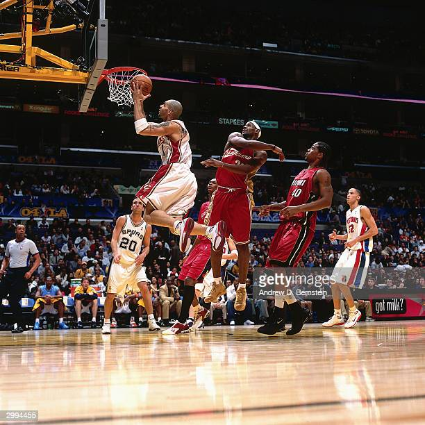 4eec2471c792 Carlos Boozer of the Sophomore Team drives to the basket against LeBron  James of the Rookie