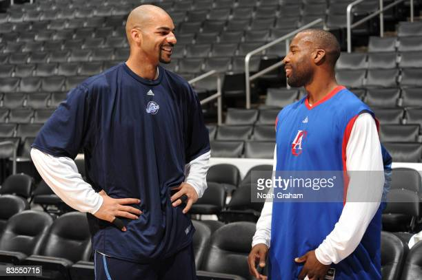 Carlos Boozer of the Utah Jazz and Baron Davis of the Los Angeles Clippers speak to each other before their game at Staples Center on November 3 2008...