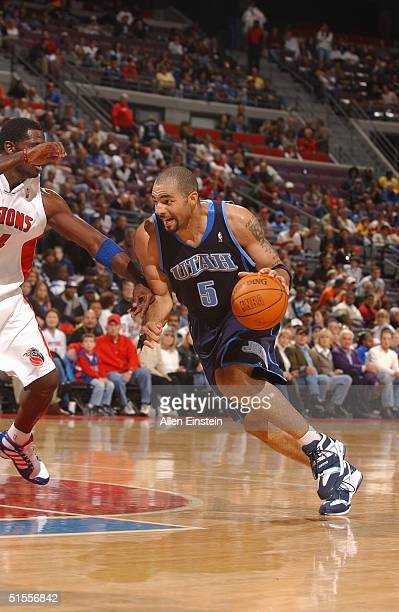 Carlos Boozer of the Utah Jazz drives against Antonio McDyess of the Detroit Pistons during their game on October 24 2004 at the Palace of Auburn...
