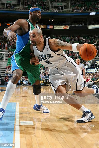 Carlos Boozer of the Utah Jazz drives to the basket against Erick Dampier of the Dallas Mavericks on December 11 2006 at the EnergySolutions Arena in...