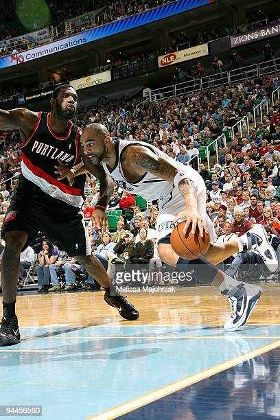 Carlos Boozer of the Utah Jazz drives to the basket against Greg Oden of the Portland Trail Blazers during the game on November 28 2009 at...