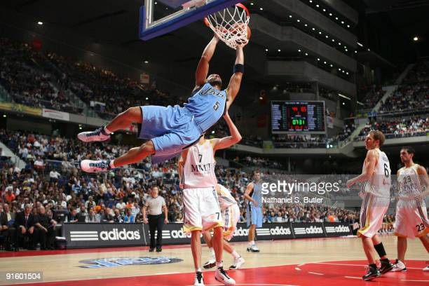 Carlos Boozer of the Utah Jazz dunks against Travis Hensen of Real Madrid in a preseason game during the 2009 NBA Europe Live Tour on October 8 2009...