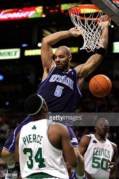 Carlos Boozer of the Utah Jazz dunks over Paul Pierce of the Boston Celtics during the game on November 10 2006 at the TD Banknorth Garden in Boston...