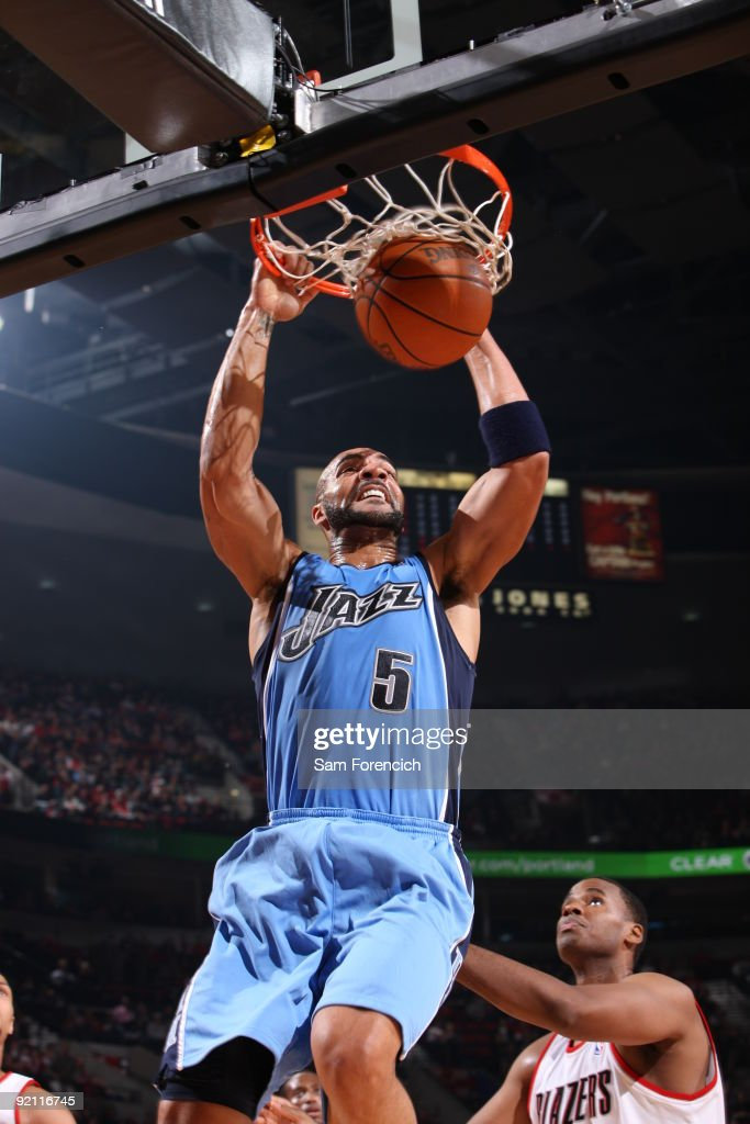 Carlos Boozer of the Utah Jazz dunks the ball over Jarron ...