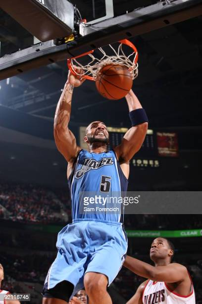 Carlos Boozer of the Utah Jazz dunks the ball over Jarron Collins of the Portland Trail Blazers in a preseason game on October 20 2009 at the Rose...