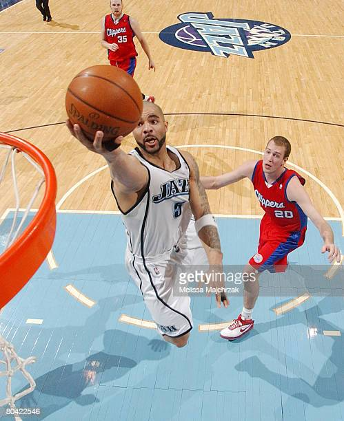 Carlos Boozer of the Utah Jazz gets past Nick Fazekas of the Los Angeles Clippers for a layup at EnergySolutions Arena on March 28, 2008 in Salt Lake...