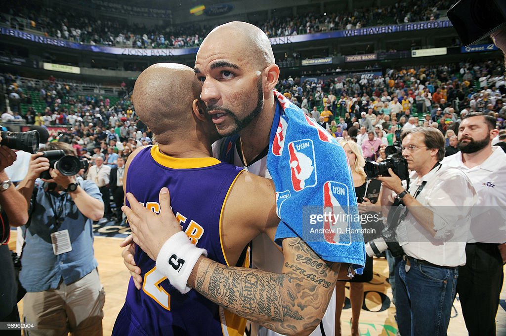 Carlos Boozer of the Utah Jazz hugs Derek Fisher of the Los Angeles Lakers in Game Four of the Western Conference Semifinals during the 2010 NBA Playoffs at the EnergySolutions Arena on May 10, 2010 in Salt Lake City, Utah.