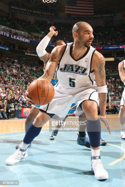 Carlos Boozer of the Utah Jazz looks to pass the ball during the game against the New Orleans Hornets at EnergySolutions Arena on March 20 2010 in...