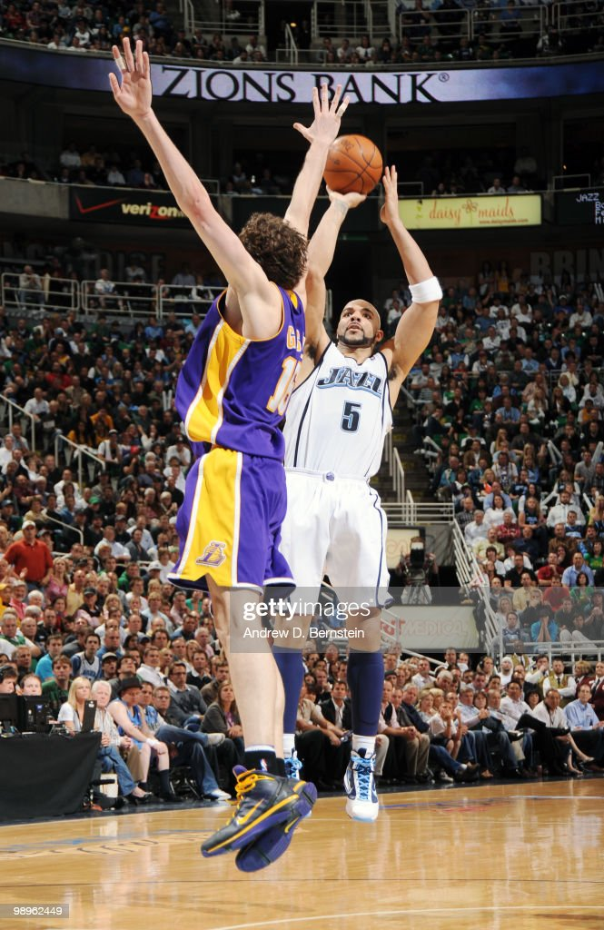 Carlos Boozer of the Utah Jazz puts the shot up over Pau Gasol of the Los Angeles Lakers in Game Four of the Western Conference Semifinals during the 2010 NBA Playoffs at the EnergySolutions Arena on May 10, 2010 in Salt Lake City, Utah.