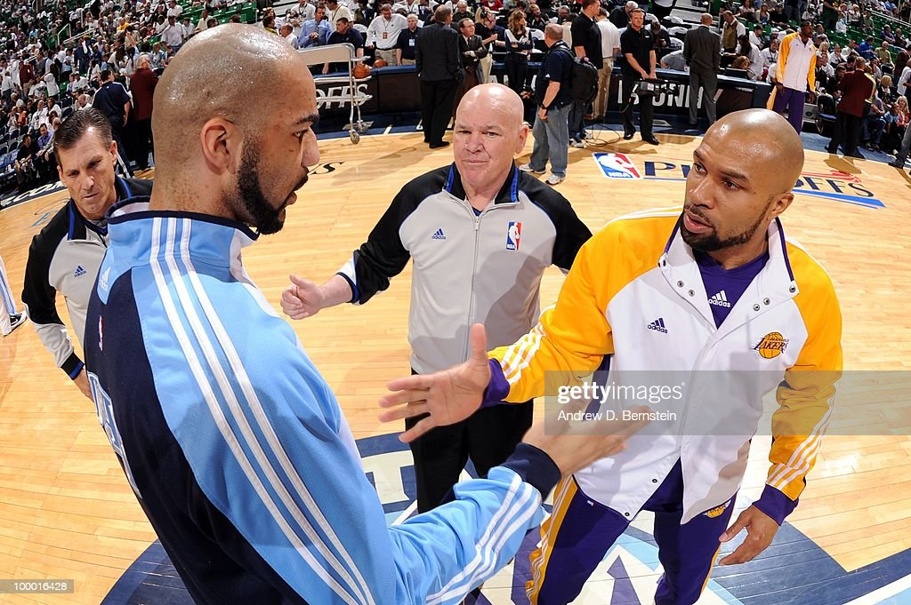 Carlos Boozer #5 of the Utah Jazz shakes hands with Derek Fisher #2 of the Los Angeles Lakers at center court prior to Game Three of the Western Conference Semifinals during the 2010 NBA Playoffs at the EnergySolutions Arena on May 8, 2010 in Salt Lake City, Utah. The Lakers won 111-110.