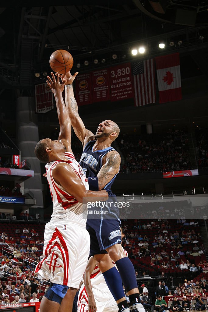 Carlos Boozer #5 of the Utah Jazz shoots the ball over Chuck Hayes #44 of the Houston Rockets on April 7, 2010 at the Toyota Center in Houston, Texas.