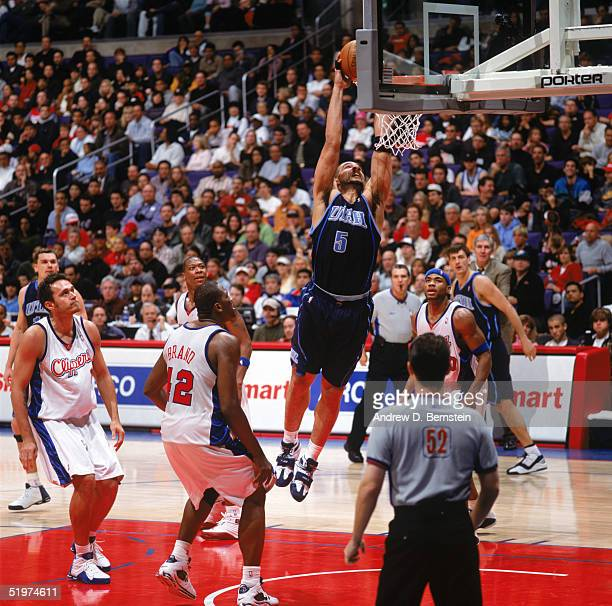 Carlos Boozer of the Utah Jazz takes the ball to the basket during a game against the Los Angeles Clippers at Staples Center on December 29 2004 in...