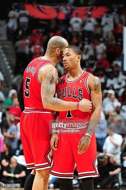 Carlos Boozer talks to Derrick Rose of the Chicago Bulls in Game Three of the Eastern Conference Semifinals against the Atlanta Hawks in the 2011 NBA...