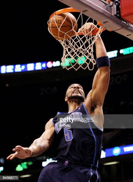 Carlos Boozer the Utah Jazz dunks against the New Jersey ...