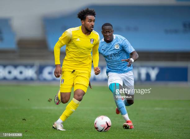 Carlos Borges of Manchester City and Luciano D'auria-Henry of Fulham during the U18 Premier League match between Manchester City and Fulham at The...