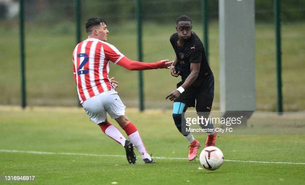 Carlos Borges of Manchester City runs past Sam Knowles of Stoke City during the U18 Premier League match between Stoke City and Manchester City at...