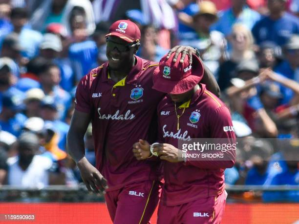Carlos Brathwaite and Shimron Hetmyer of West Indies celebrates the dismissal of Rohit Sharma of India during the 2nd T20i match between West Indies...