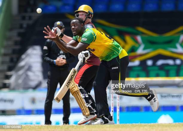Carlos Brathwaite of Jamaica Tallawahs takes the catch to dismiss Lendl Simmons of Trinbago Knight Riders during the 2021 Hero Caribbean Premier...
