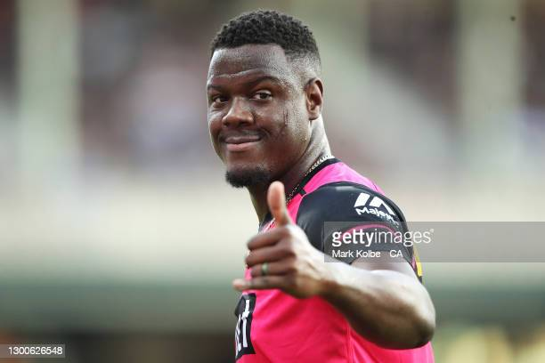 Carlos Brathwaite of the Sixers acknowledges the crowd during the warm-up before the Big Bash League Final match between the Sydney Sixers and the...