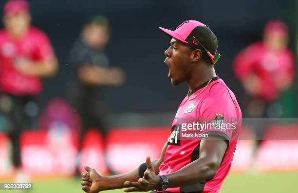 Carlos Brathwaite of the Sixers celebrates taking a catch during the Big Bash League match between the Sydney Sixers and the Brisbane Heat at Sydney...