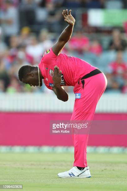 Carlos Brathwaite of the Sixers celebrates taking the wicket of Liam Livingstone of the Scorchers during the Big Bash League match between the Sydney...