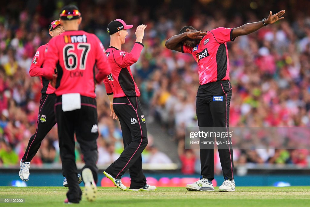 Carlos Brathwaite of the Sixers celebrates taking the wicket of Usman Khawaja of the Thunder during the Big Bash League match between the Sydney Sixers and the Sydney Thunder at Sydney Cricket Ground on January 13, 2018 in Sydney, Australia.