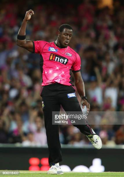 Carlos Brathwaite of the Sixers celebrates taking the wicket of Yasir Shah of the Heat during the Big Bash League match between the Sydney Sixers and...