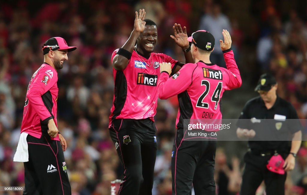 Carlos Brathwaite of the Sixers celebrates with team mates after taking the wicket of Yasir Shah of the Heat during the Big Bash League match between the Sydney Sixers and the Brisbane Heat at Sydney Cricket Ground on January 18, 2018 in Sydney, Australia.