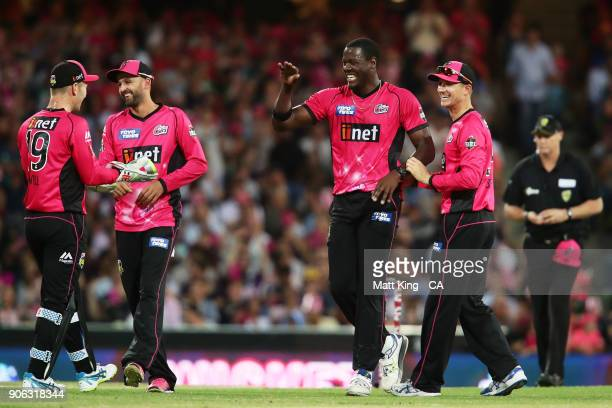 Carlos Brathwaite of the Sixers celebrates with team mates after taking the wicket of Yasir Shah of the Heat during the Big Bash League match between...