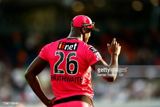 Carlos Brathwaite of the Sixers looks into the sun while fielding during the Big Bash League match between the Sydney Thunder and the Sydney Sixers...
