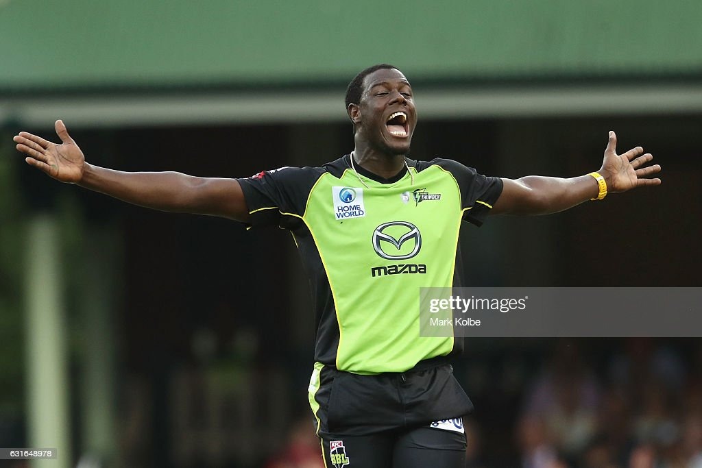 Carlos Brathwaite of the Thunder celebrates taking the wicket of Brad Haddin of the Sixers during the Big Bash League match between the Sydney Sixers and the Sydney Thunder at Sydney Cricket Ground on January 14, 2017 in Sydney, Australia.