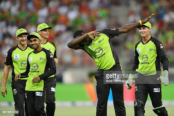 Carlos Brathwaite of the Thunder celebrates taking the wicket of Tim Ludeman of the Strikers during the Big Bash League match between the Sydney...