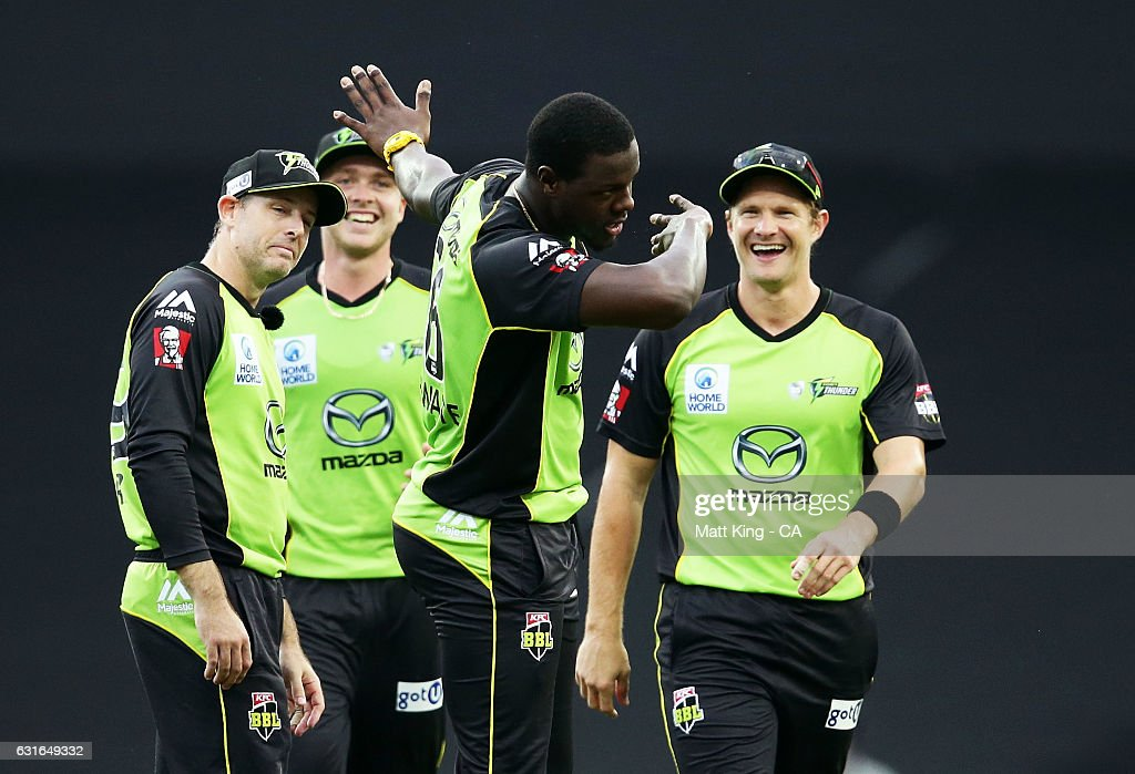 Carlos Brathwaite of the Thunder celebrates with team mates after taking the wicket of Johan Botha of the Sixers during the Big Bash League match between the Sydney Sixers and the Sydney Thunder at Sydney Cricket Ground on January 14, 2017 in Sydney, Australia.