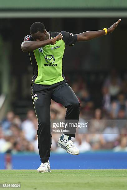 Carlos Brathwaite of the Thunder dabs as he celebrates taking the wicket of Brad Haddin of the Sixers during the Big Bash League match between the...
